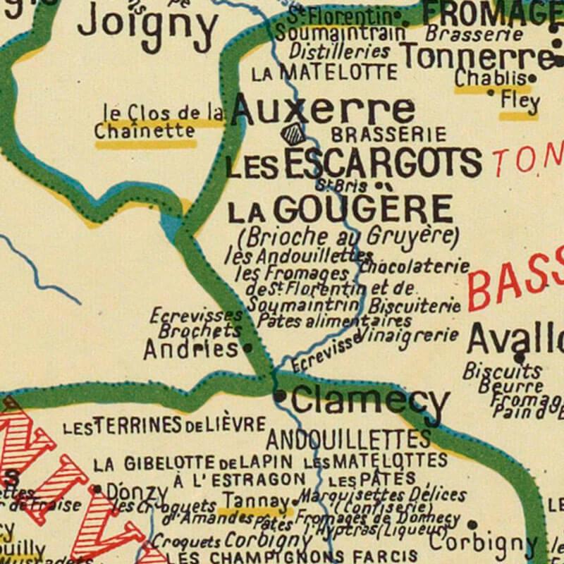 Gros plan sur une carte de France de la gastronomie de 1929, montrant des écrevisses et des brochets à Andries.